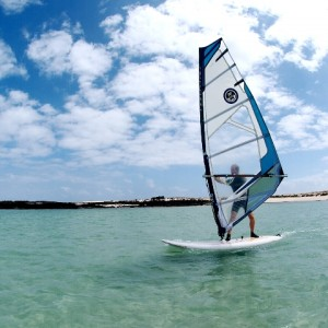 Learning windsurfing in fuerteventura in the shallow waters on Cotillo lagoon